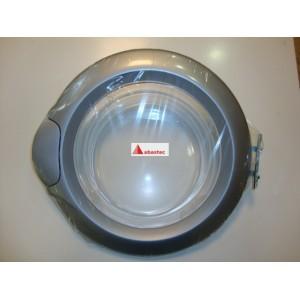 Ojo con marco gris lavadora TKE1200T (bisagra anterior)